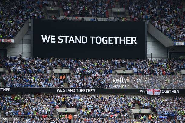 TOPSHOT Supporters applaud in the 22nd minute of the game for the victims of the Manchester bombing during the English Championship playoff final...