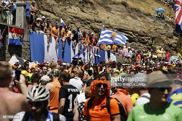 Supporters are pictured at the Alpe d'Huez's Dutch Corner during the 1105 km twentieth stage of the 102nd edition of the Tour de France cycling race...