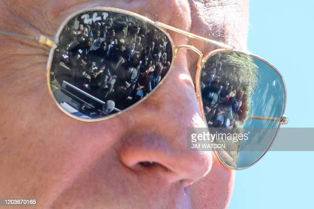 Supporters are reflected in the Ray Ban sunglasses of Democratic presidential candidate Joe Biden as he speaks at St. James Santee Family Health...