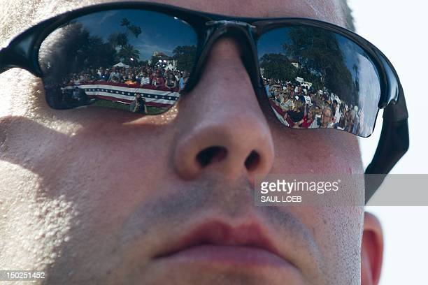f32d0c27ea5 Supporters are reflected in the sunglasses of a Secret Service agent as US  Republican presidential candidate