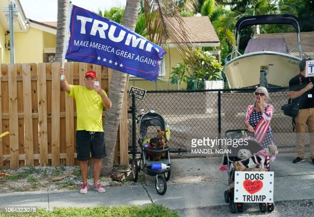 Supporters are seen as US President Donald Trump arrives for a visit to US Coast Guard Station Lake Worth Inlet in Riviera Beach on Thanksgiving Day...