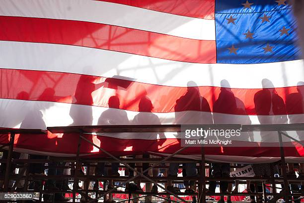 Supporters are seen backstage through an American flag during a Republican presidential candidate Donald Trump rally at the The Northwest Washington...