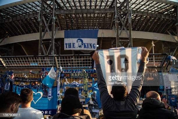 Supporters are seen mourning the death of soccer player Diego Armando Maradona at the San Paolo stadium on November 26, 2020 in Naples, Italy. Diego...