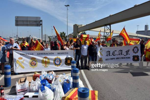 BARCELONA BARCELONA CATALONIA SPAIN Supporters are seen raising Spain flags while holding banners during a demonstration in the port of Barcelona A...