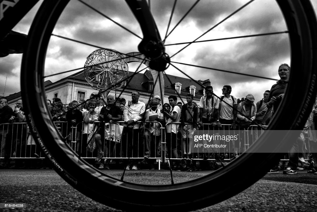 Supporters are seen through a wheel prior to the 178 km tenth stage of the 104th edition of the Tour de France cycling race on July 11, 2017 between Perigueux and Bergerac. /