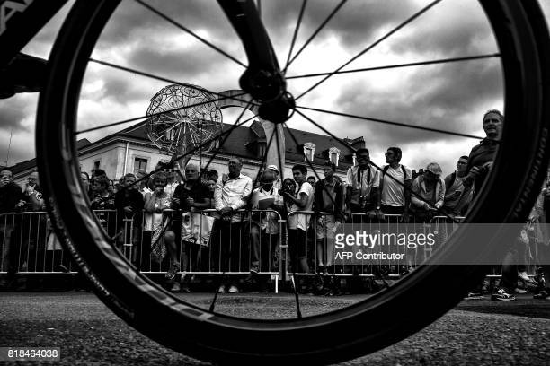 Supporters are seen through a wheel prior to the 178 km tenth stage of the 104th edition of the Tour de France cycling race on July 11, 2017 between...