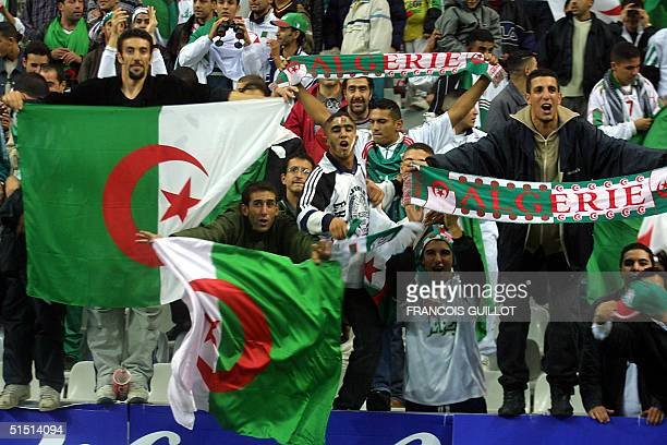 supporters are showing the Algerian flag before the friendly soccer match France vs Algeria at the Stade de France in SaintDenis 06 October 2001 AFP...