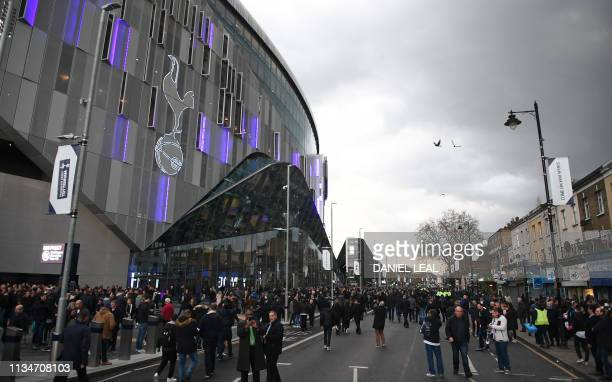 Supporters arrive ahead of the first Premier League game to be played at their new stadium the English Premier League football match between...
