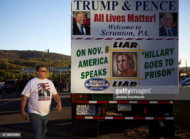 Supporters arrive at a campaign rally for Republican presidential nominee Donald Trump on October 10 2016 in WilkesBarre Pennsylvania Trump continues...
