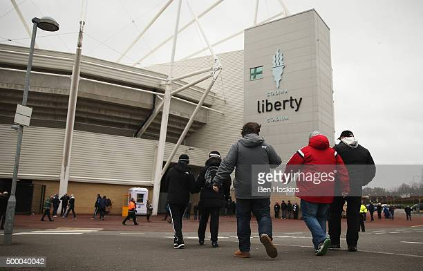 Supporters arrive at the stadium prior to the Barclays Premier League match between Swansea City and Leicester City at Liberty Stadium on December 5...