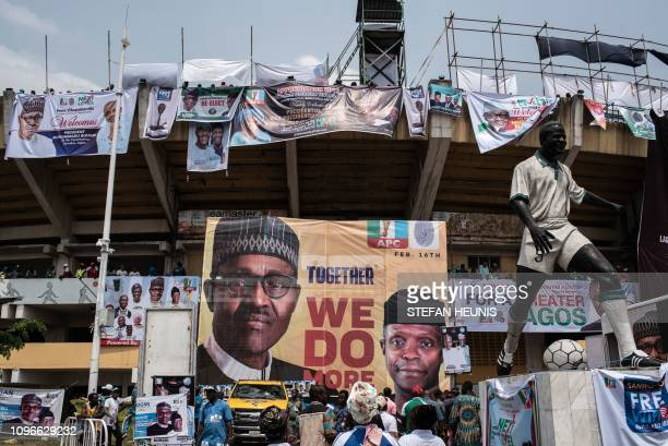 Supporters arrive at the Teslim Balogun Stadium in Lagos in order to attend the arrival of Nigeria's President Muhammadu Buhari for the political...