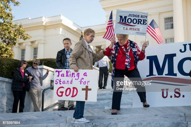 Supporters arrive for a Women For Moore' rally in support of Republican candidate for US Senate Judge Roy Moore in front of the Alabama State Capitol...