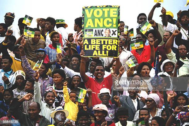 Supporters at an ANC rally in South Africa wait to cheer President Nelson Mandela