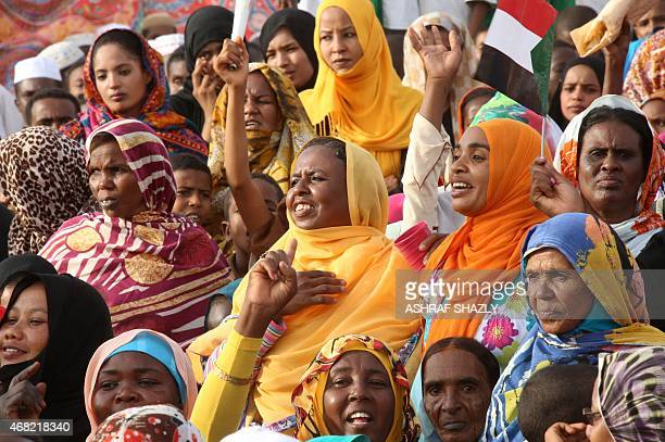 Supporters attend a campaign meeting of the incumbent president and candidate of the ruling National Congress Party for Sudans presidency Omar...