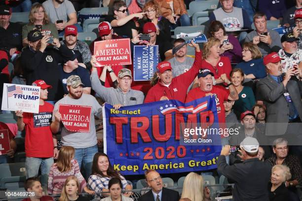 Supporters attend a campaign rally with US President Donald Trump at the MidAmerica Center on October 9 2018 in Council Bluffs Iowa The rally is one...