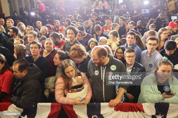 Supporters attend a caucus night watch party for Democratic presidential candidate Sen Elizabeth Warren on February 03 2020 in Des Moines Iowa Iowa...