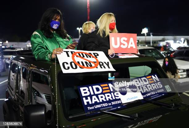 Supporters attend a drive-in election night event for Democratic presidential nominee Joe Biden at the Chase Center on November 03, 2020 in...