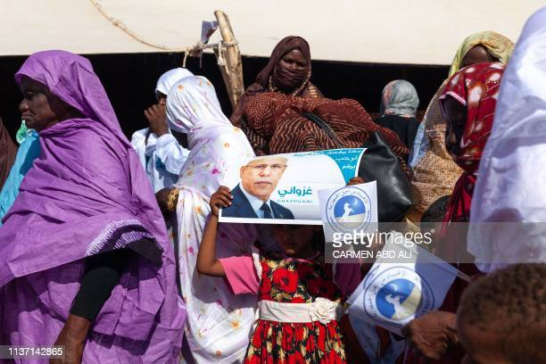 Supporters attend a political rally of Union pour la Republique party's candidate Mohamed O Gazhouani supported by the running political party in...
