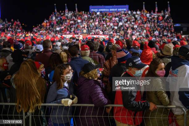 Supporters attend a rally by U.S. President Donald Trump at North Coast Air aeronautical services at Erie International Airport on October 20, 2020...