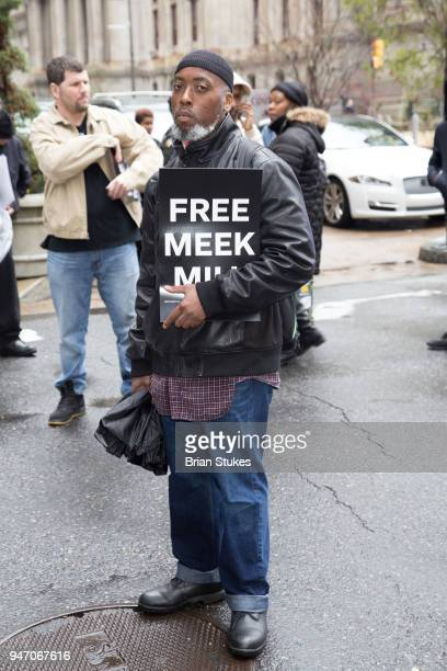 Supporters attend a rally protesting the imprisonment of Meek Mill outside the Philadelphia Criminal Justice Center during the rapper's status...