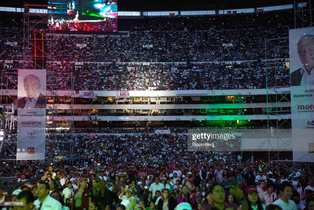 Supporters attend the final campaign rally for Andres Manuel Lopez Obrador, presidential candidate of the National Regeneration Movement Party (MORENA), at the Estadio Azteca in Mexico City, Mexico, on Wednesday, June 27, 2018. Lopez Obrador promises to put the poor first with a raft of new social programs -- and to stand up to the U.S. President, who has been denouncing Mexico since before he got elected. Photographer: Alejandro Cegarra/Bloomberg via Getty Images
