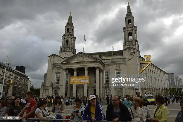 Supporters attend the team presentation parade in streets of Leeds western England on July 3 before the start of the 101st edition of the Tour de...