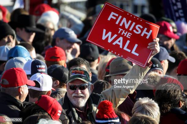 Supporters await the arrival of President Donald Trump during a rally at the Tupelo Regional Airport November 26 2018 in Tupelo Mississippi President...