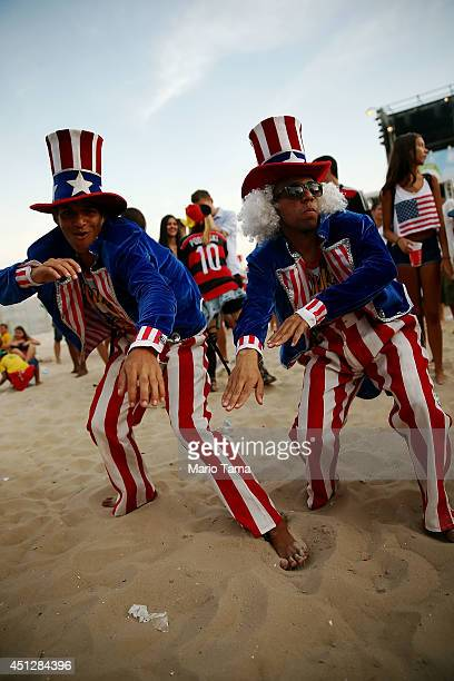 Supporters celebrate advancing to the Round of 16 after a loss to Germany at FIFA Fan Fest on June 26, 2014 in Rio de Janeiro, Brazil. The U.S. Lost...