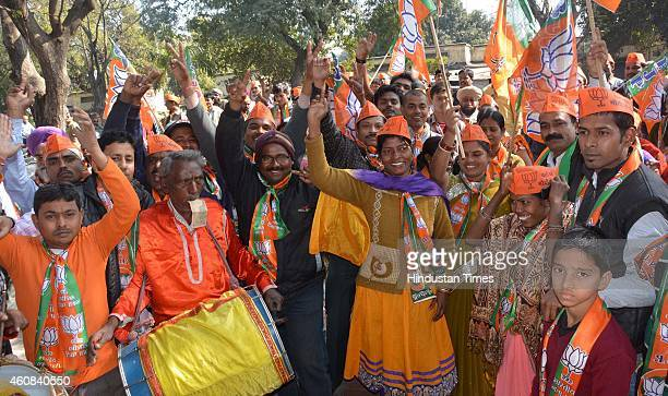 BJP supporters celebrate after election of Raghuvar Das as the Chief Minister of Jharkhand on December 27 2014 in Jamshedpur India BJPAJSU party...