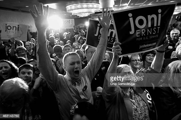 Supporters celebrate after hearing that Republican candidate Joni Ernst won the US Senate race on election night at the Marriott Hotel November 4...