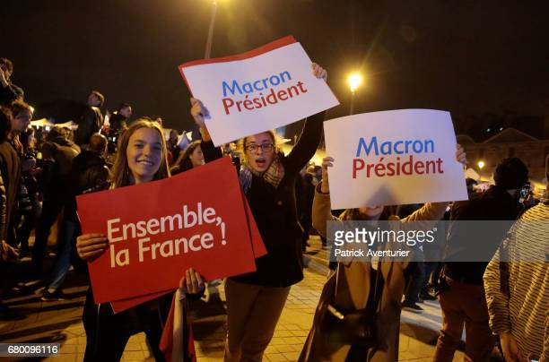 Supporters celebrate after leader of 'En Marche ' Emmanuel Macron wins the French Presidential Election at The Louvre on May 7 2017 in Paris...