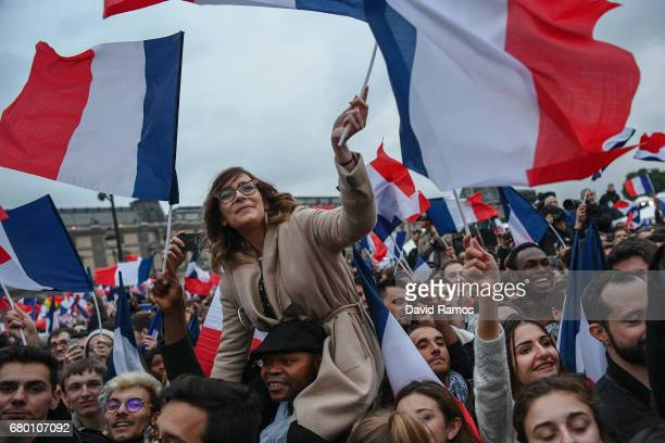 Supporters celebrate after leader of 'En Marche ' Emmanuel Macron wins the French Presidential Election at The Louvre on May 7 2017 in Paris France...