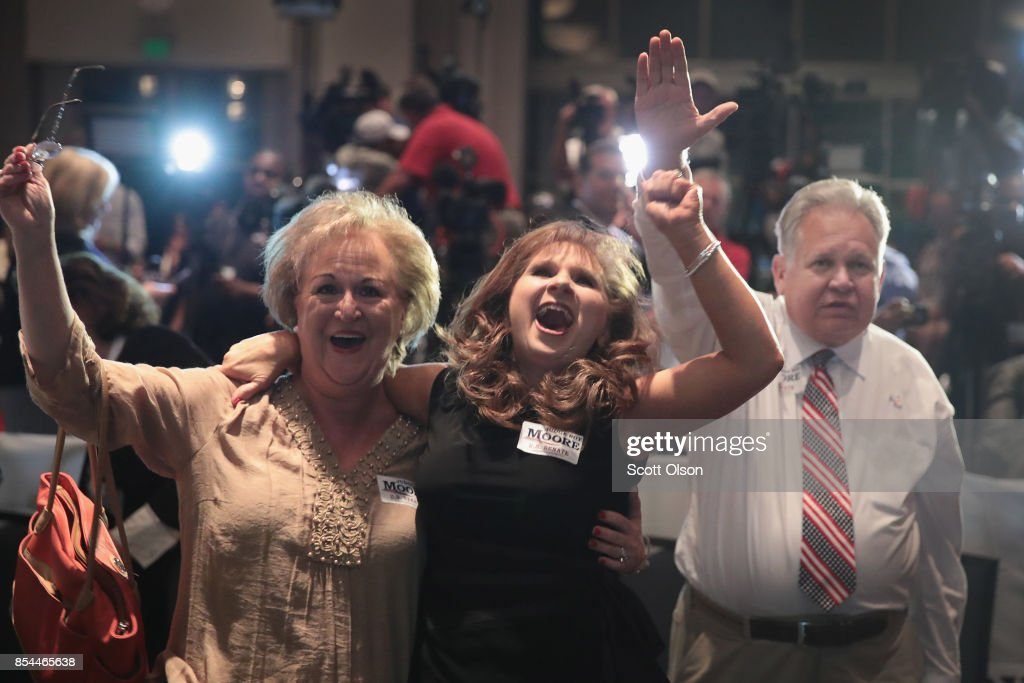 Supporters celebrate after Roy Moore defeated incumbent Sen. Luther Strange (R-AL) in a primary runoff election for the Senate seat vacated when Jeff Sessions was appointed U.S. Attorney General by President Donald Trump on September 26, 2017 in Montgomery, Alabama. Moore, former chief justice of the Alabama supreme court, will now face Democratic candidate Doug Jones in the general election in December.