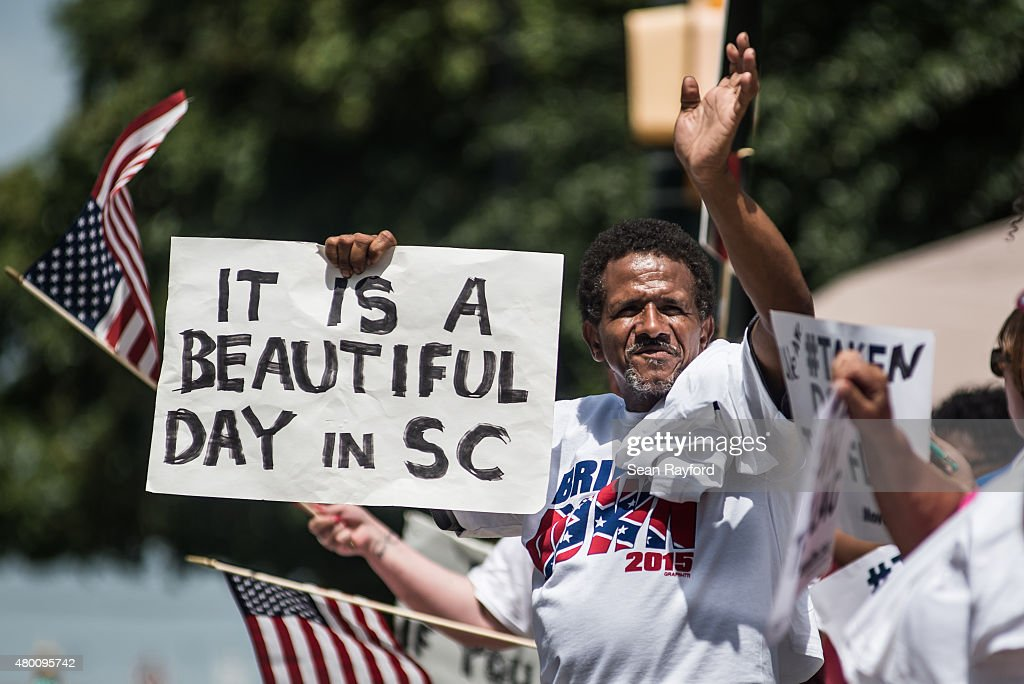 Supporters celebrate after South Carolina Governor Nikki Haley signs a bill to remove the Confederate battle flag from the state house grounds July 9, 2015 in Columbia, South Carolina. Debate on the flag was reignited three weeks ago after the mass murder at Emanuel AME Church in Charleston, South Carolina.