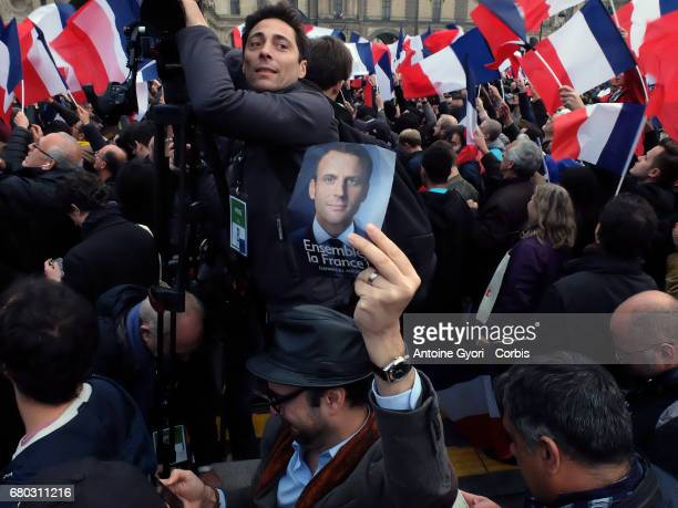 Supporters celebrate at a rally for Emmanuel Macron outside the Louvre on May 7 2017 in Paris France