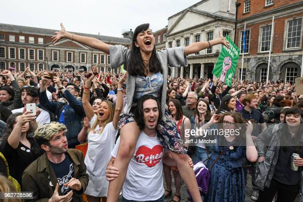 Supporters celebrate at Dublin Castle following the result Irish referendum result on the 8th amendment concerning the country's abortion laws on May...