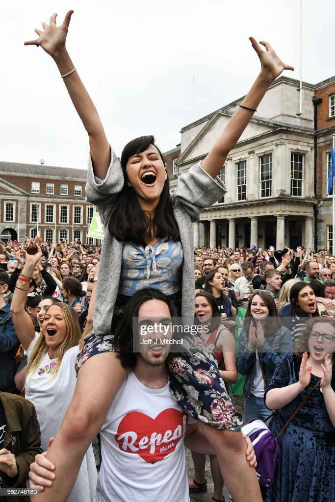 Supporters celebrate at Dublin Castle following the result Irish referendum result on the 8th amendment, concerning the country's abortion laws, on May 26, 2018 in Dublin, Ireland. Ireland has voted in favour of overturning the abortion ban by 66.4% to 33.6%, which is a 'resounding' victory for the yes campaign.