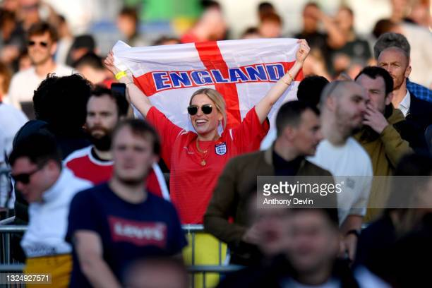 Supporters celebrate England's first goal at the 4TheFans Fan Park at Event City on June 22, 2021 in Manchester, England. England are already through...