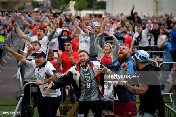 Supporters celebrate England's first goal at the 4TheFans Fan Park at Event City on July 07, 2021 in Manchester, United Kingdom. England has reached...