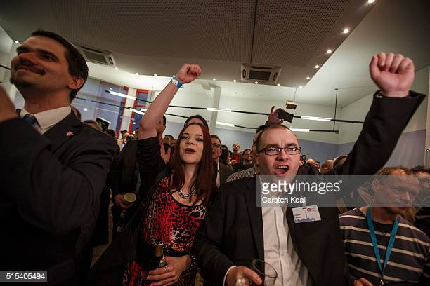 Supporters celebrate following initial state election results on March 13 2016 in Berlin Germany State elections taking place today in three German...