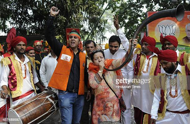 BJP supporters celebrate following the results of Haryana and Maharashtra state assembly elections at BJP party headquarters on October 19 2014 in...