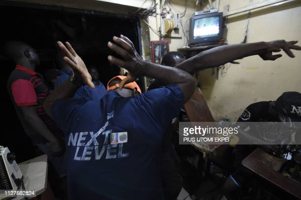 Supporters celebrate in a shop the reelection of the candidate of the ruling All Progressives Congress President Mohammadu Buhari at Obalende...