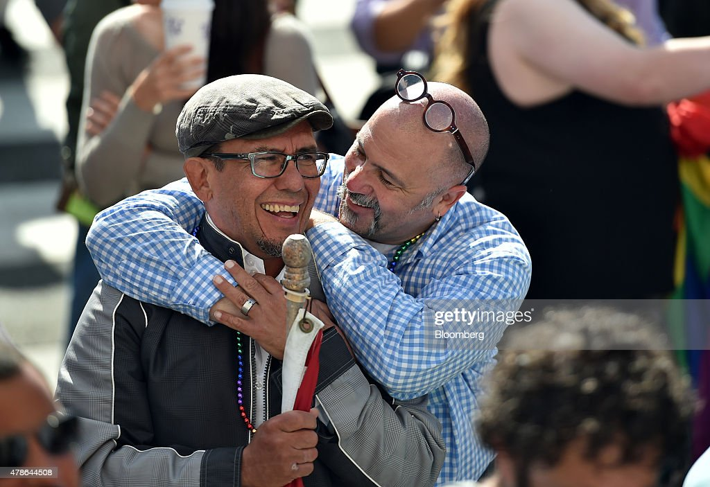 Supporters celebrate outside City Hall after the U.S. Supreme Court same-sex marriage ruling in San Francisco, California, U.S., on Friday, June 26, 2015. Same-sex couples have a constitutional right to marry nationwide, the U.S. Supreme Court said in a historic ruling that caps the biggest civil rights transformation in a half-century. Photographer: Josh Edelson/Bloomberg via Getty Images