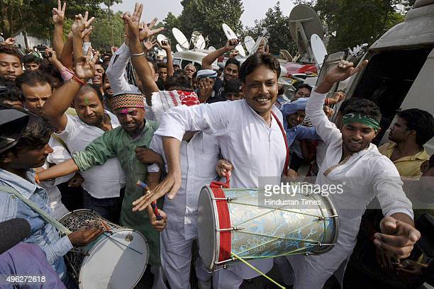 Supporters celebrate outside RJD Chief Lalu Prasad Yadav's residence on the vote counting day of the Bihar assembly elections on November 8 2015 in...