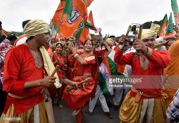 Supporters celebrate Prime Minister Narendra Modis arrival from the US, at Palam technical Airport, on September 26, 2021 in New Delhi, India....