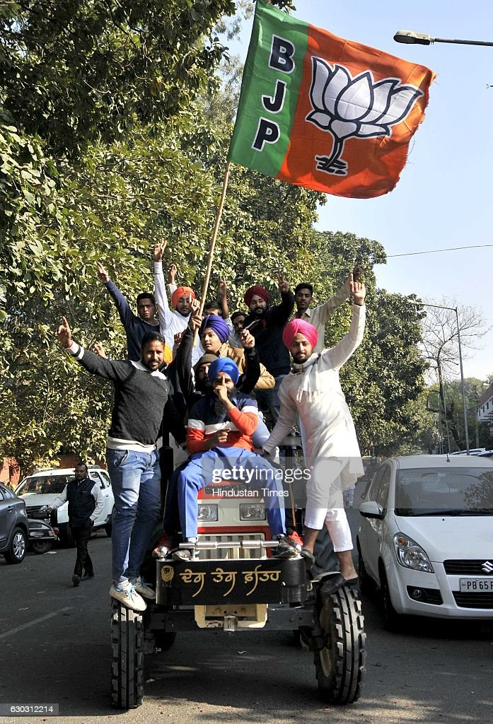 SAD supporters celebrate their victory after winning the MC election at sector 42 outside one of the counting center on December 20 2016 in...