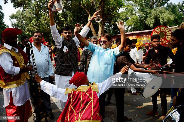 BJP supporters celebrating the party's victory in Haryana and Maharashtra assembly elections in New Delhi