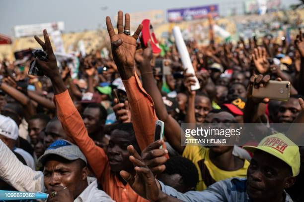Supporters chant slogans and gesture during the political campaign rally of the Nigeria's ruling party All Progressive Congress at the Teslim Balogun...