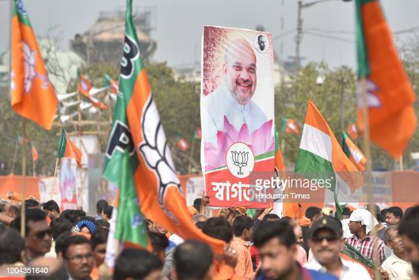 Supporters chant slogans during Union Home Minister Amit Shah's mass rally in support of Citizenship Amendment Act and National Register of Citizens...