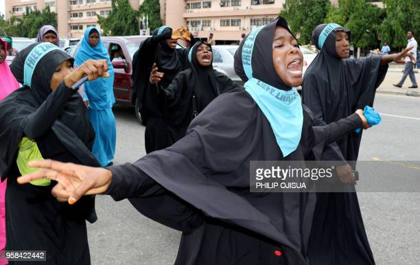 Supporters chant slogans to march and press for the release of Nigerian Shiite Muslim cleric Ibrahim Zakzaky on May 14, 2018 in Abuja. - The...